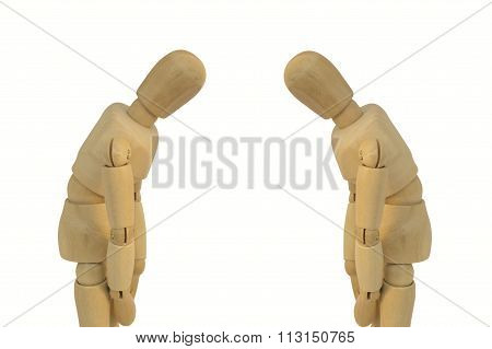 Two Wooden Figure Bow Eachother Concept