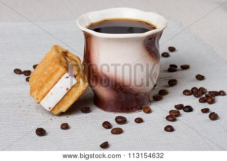 Cup Of Coffee, Waffles And Coffee Beans On The Table