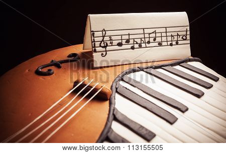 Cake In Shape Of Piano And Cello