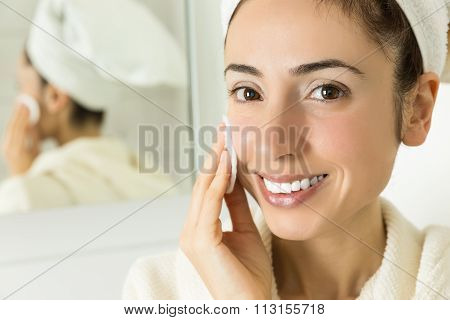 Woman Cleaning Her Facial Skin