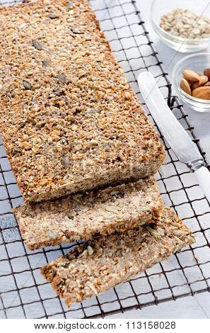 Loaf of healthy seeded multi grain whole wheat wholemeal bread with nuts, pumpkin, sunflower, sesame, flax seeds and almonds