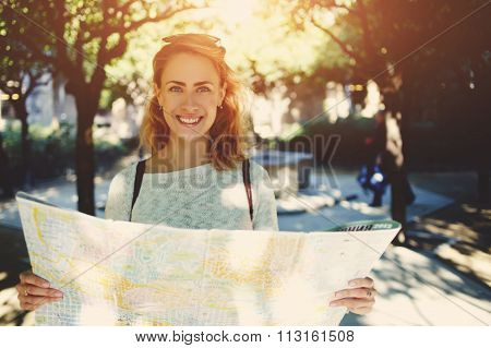 Woman tourist seeking way to the places of interest during her spring trip