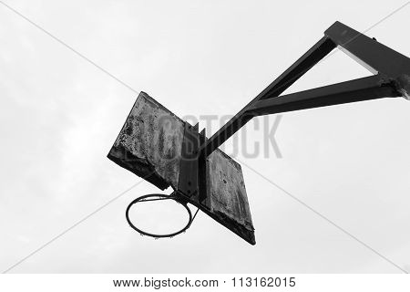A Black And White Photo Of An Old Basketball Ring With A White Wooden Plate Where Paint Is Peeling O