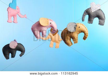 Fleece elephants on light blue background