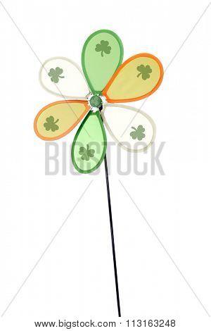 A green, orange and white Irish pinwheel with a shamrock on each blade.  Isolated on white.
