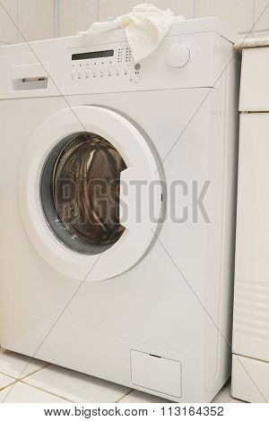 The image of washing machine at the bathroom