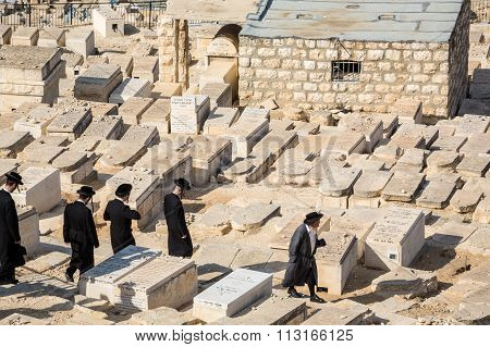 Orthodox Jews Walking Among Graves On The Mount Of Olives