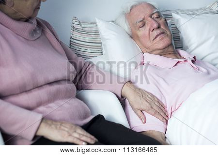 Woman Supporting Man With Disease