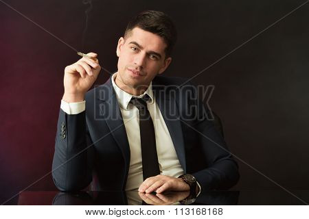 Boss With Smirk Smoking Cigarette