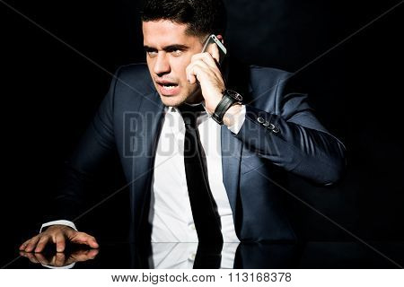 Angry Businessman Talking On Phone