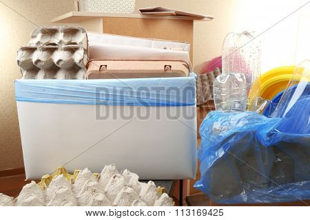 Pile of different waste, indoors. Waste sorting concept
