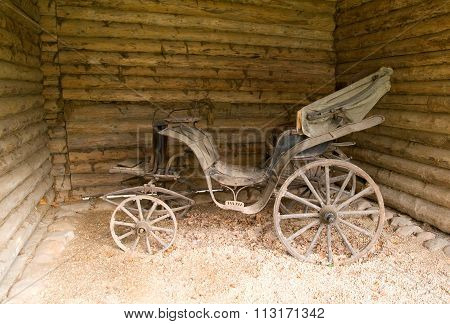 Old carriage horse in a wooden shed