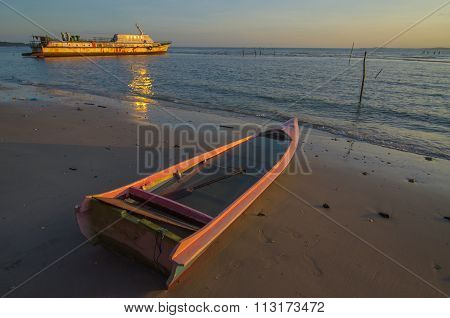 The Wrecked Ship & Fisherman Boat with sunrise at Kg. Nagalang, Labuan, Malaysia.