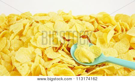 The tasty golden corn flakes with the green plastic spoon