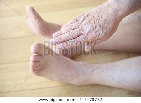 Sitting man tries to touch toes