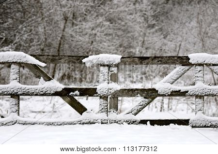 Old Wooden Farm Fence Gate Convered In Winter Snow