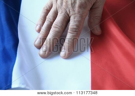 Hand Of Man On French Flag
