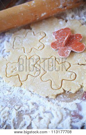 Making teddy bear-shaped sugar cookies