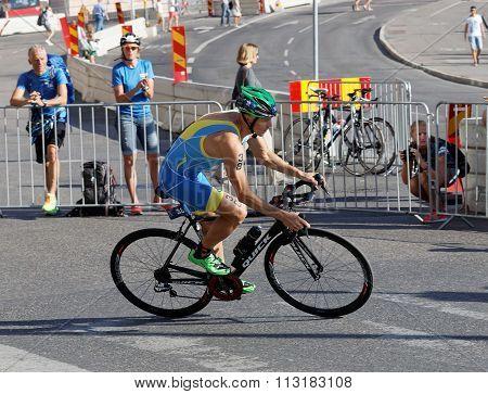 Side View Of Cycling Triathlon Athlete Danylo Supunov