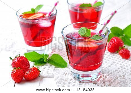 homemade strawberry compote with fresh berries, mint and ice cubes