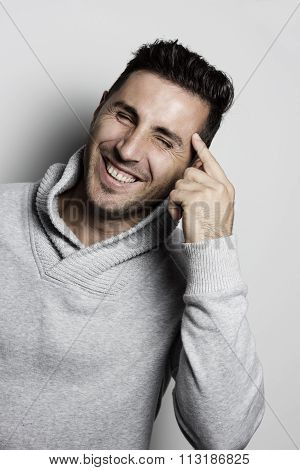 Atractive Laughing Man Pointing With Finger His Head