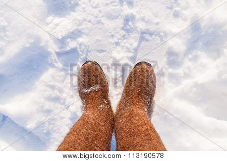Russian Traditional Winter Footwear - Valenki. Winter Sunny Day, Top View On Feet Felted Wool Boots.
