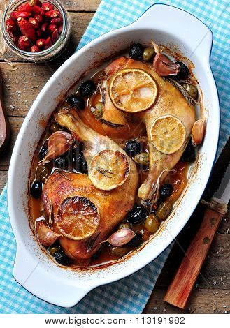 roast chicken legs with onion, olives, garlic, lemon and rosemary
