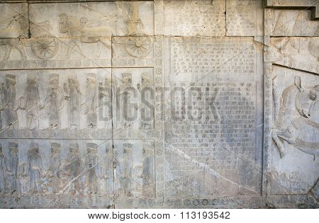Silhouettes Of Historical People On Stone Bas-relief In Famous City Persepolis, Modern Iran.