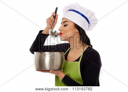 Beautiful Woman Cook Tasting Soup