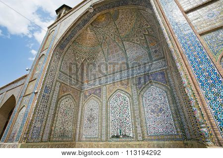 Historical Mosque With Tiled Walls And Persian Patterns In Iran
