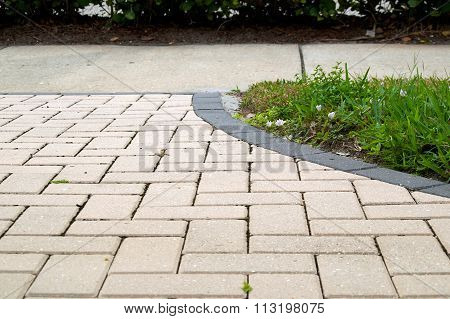 Curved Walkway With Rectangular Pavers