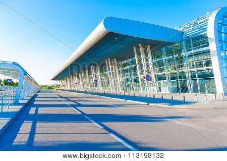 Airport terminal outside, flight departure gate and airport parking at sunny morning