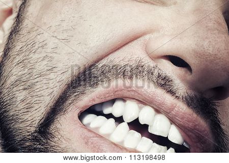 Male Mouth With Bared Teeth