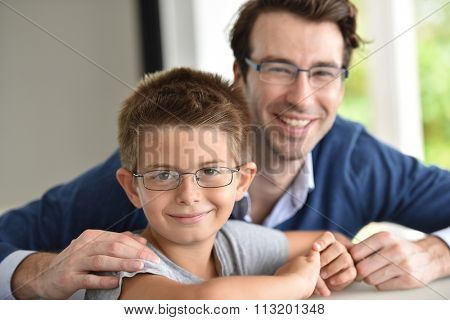 Young boy and daddy wearing eyeglasses