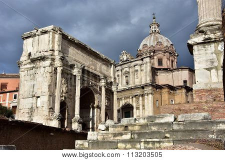 Arch Of Septimius Severus With Saint Luca And Martina Church In Rome
