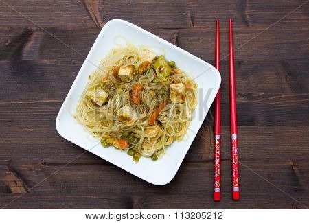 Bean vermicelli with vegetables on wood from above