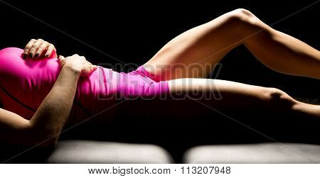 Body Of Woman In Pink Hightlighted On Back