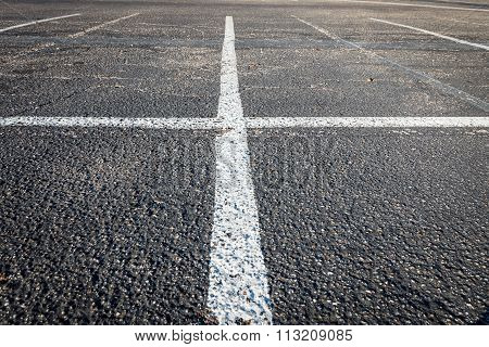 White Lines Intersect On Parking Lot