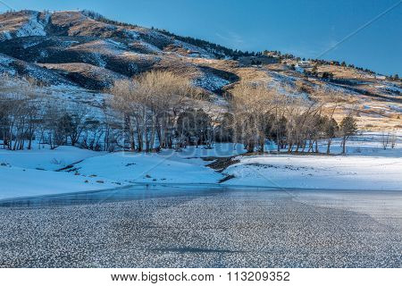 frozen Horsetooth Reservoir and Lory State Park at winter sunset, Fort COllins, COlorado