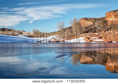 sandstone cliff over Horsetooth Reservoir and Lory State Park at winter sunset, Fort Collins, Colorado