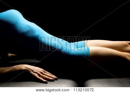 Woman Body In Blue Hightlighted On Back With Hand