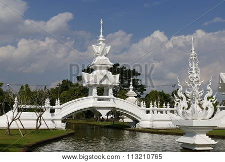 White Gazebo On The Bridge Across The Pond