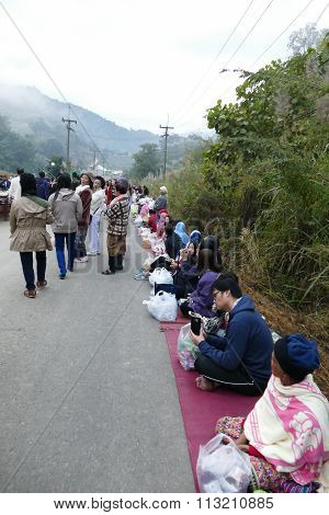 People Waiting To Offer Food To Buddhist Monk In Food Offering Traditional Ceremony Between Thailand