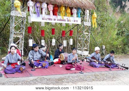 Musician Playing Traditional Music In Food Offering Traditional Ceremony Between Thailand And Laos