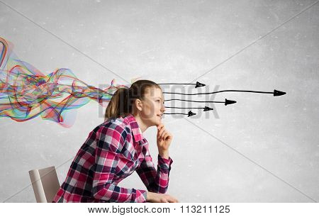 Pretty young woman making decision with arrows coming out of her head