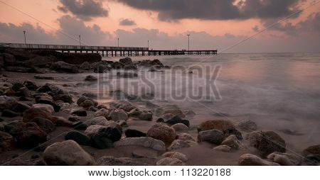 Seascape With Pier And Dramatic Sunset