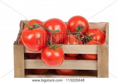 Fresh Tomatoes In A Wooden Crate Isolate On A White Background