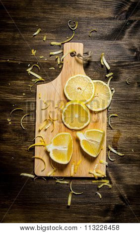 Cut The Lemon Zest On The Board. On Wooden Table.