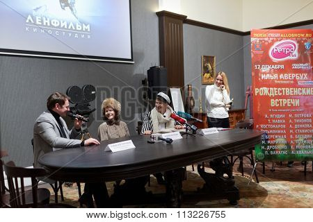 ST. PETERSBURG, RUSSIA - NOVEMBER 25, 2015: Press conference of A. Yagudin (right), M. Petrova, and A. Tikhonov (left). Famous figure skaters presented the Christmas shows of Ilya Averbukh