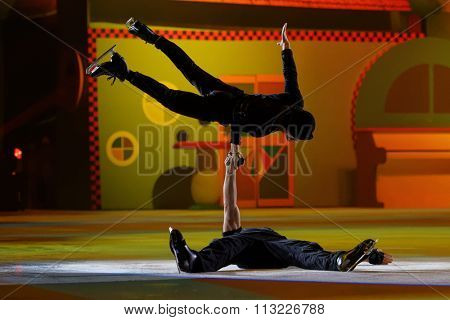 ST. PETERSBURG, RUSSIA - DECEMBER 29, 2015: Figure skaters Vladimir Besedin and Alexey Polishchuk (top) in a scene of the New Year show Little Brother and Karlsson-on-the-Roof of Ilya Averbukh